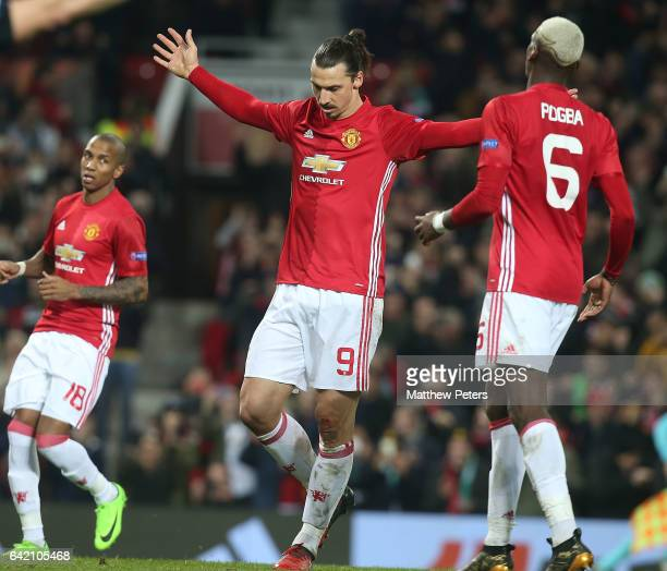Zlatan Ibrahimovic of Manchester United celebrates scoring their third goal during the UEFA Europa League Round of 32 first leg match between...