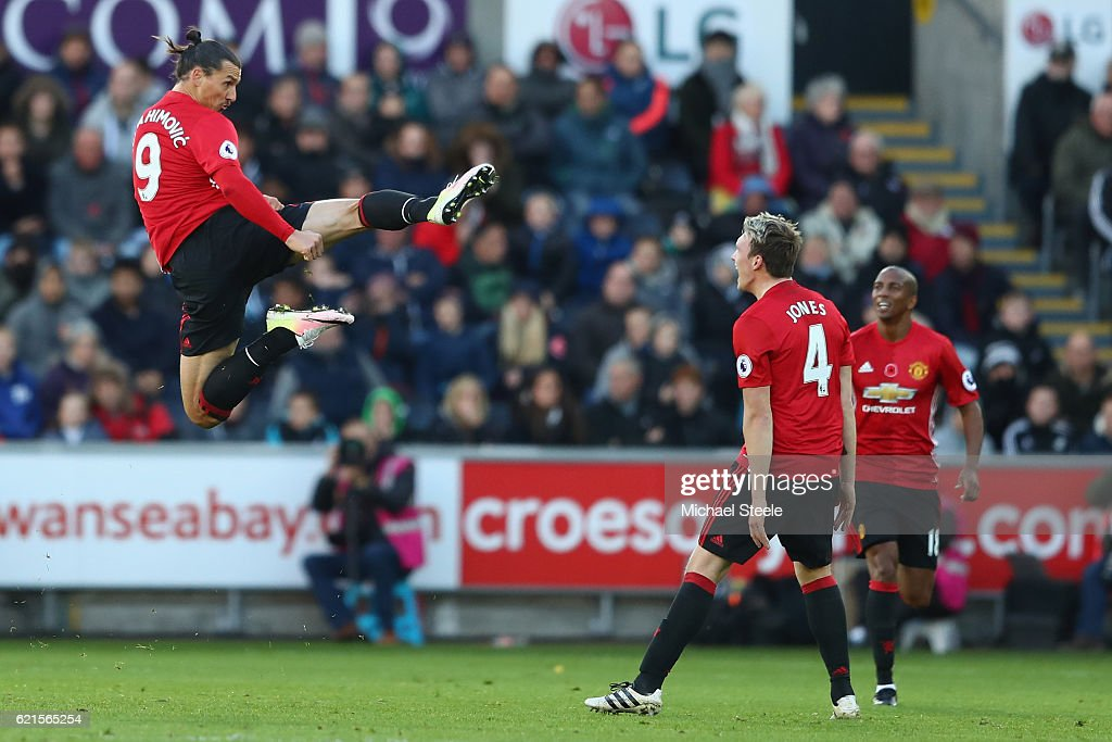 Zlatan Ibrahimovic (L) of Manchester United celebrates towards Phil Jones (R) after scoring his sides second goal during the Premier League match between Swansea City and Manchester United at the Liberty Stadium on November 6, 2016 in Swansea, Wales.