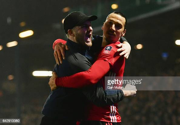 Zlatan Ibrahimovic of Manchester United celebrates with a fans as he runs onto the pitch as he scores their second goal during The Emirates FA Cup...