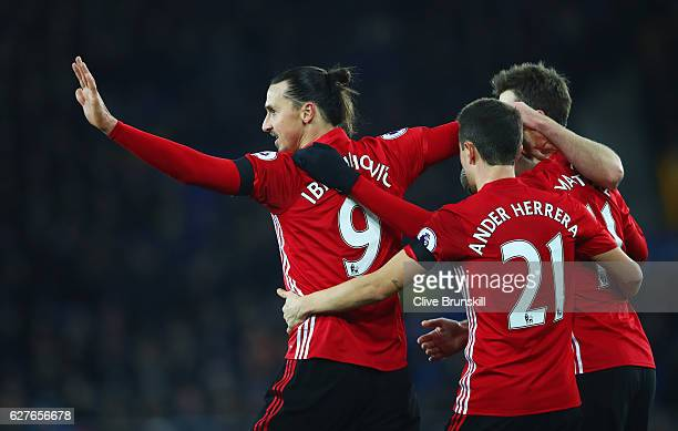 Zlatan Ibrahimovic of Manchester United celebrates with team mates as he scores their first goal during the Premier League match between Everton and...