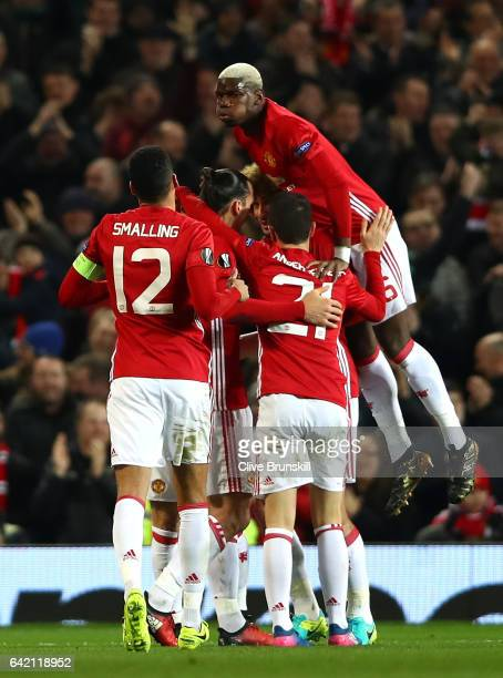 Zlatan Ibrahimovic of Manchester United celebrates with team mates after scoring his sides first goal during the UEFA Europa League Round of 32 first...