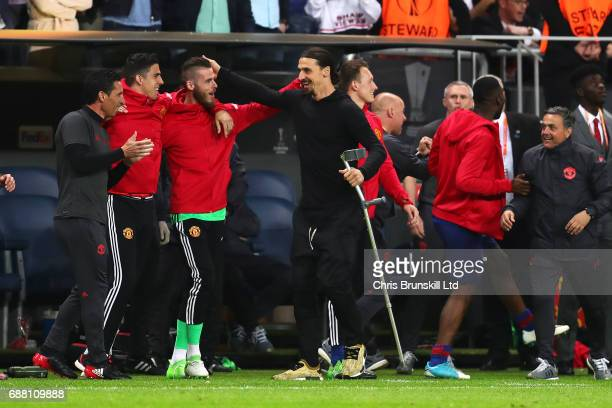 Zlatan Ibrahimovic of Manchester United celebrates with teammate David Di Gea on the touchline during the UEFA Europa League Final match between Ajax...