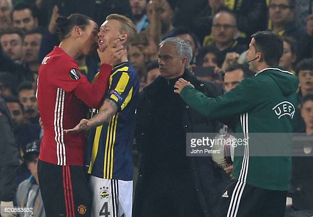 Zlatan Ibrahimovic of Manchester United clashes with Simon Kjaer of Fenerbahce during the UEFA Europa League match between Manchester United and...