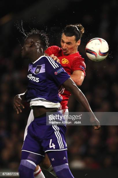 Zlatan Ibrahimovic of Manchester United competes with Kara Mbodji of Anderlecht in the air during the UEFA Europa League quarter final second leg...