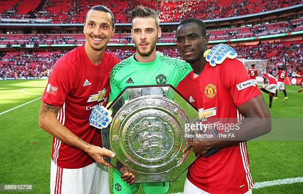 Zlatan Ibrahimovic of Manchester United David De Gea of Manchester United Eric Bailly of Manchester United pose with the Community Shield trophy...