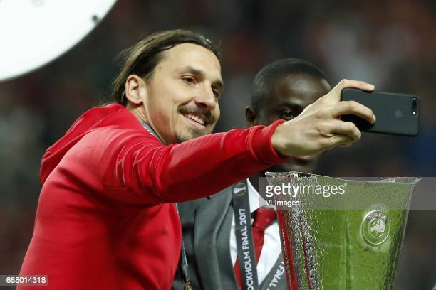 Zlatan Ibrahimovic of Manchester United Eric Bailly of Manchester United making a selfie with the Coupe UEFA the UEFA cupduring the UEFA Europa...