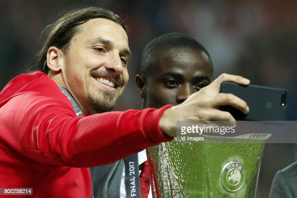 Zlatan Ibrahimovic of Manchester United Eric Bailly of Manchester United making a selfie with the Coupe UEFA the UEFA cupduring the UEFA Europa...