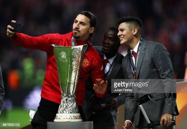 Zlatan Ibrahimovic of Manchester United Eric Bailly of Manchester United and Marcos Rojo of Manchester United take a selfie photograph with the...
