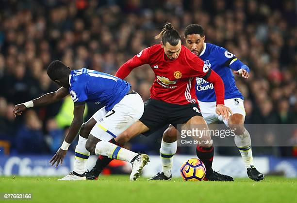 Zlatan Ibrahimovic of Manchester United goes between Idrissa Gueye and Ashley Williams of Everton during the Premier League match between Everton and...