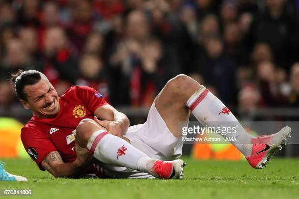 Zlatan Ibrahimovic of Manchester United goes down injured during the UEFA Europa League quarter final second leg match between Manchester United and...