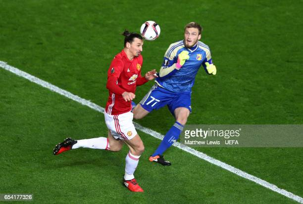 Zlatan Ibrahimovic of Manchester United heads the ball as goalkeeper Nikita Medvedev of FC Rostov closes in during the UEFA Europa League Round of 16...