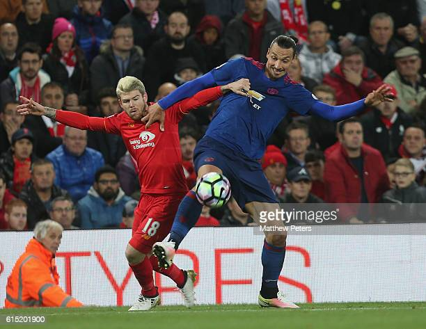 Zlatan Ibrahimovic of Manchester United in action with Alberto Moreno of Liverpool during the Premier League match between Liverpool and Manchester...