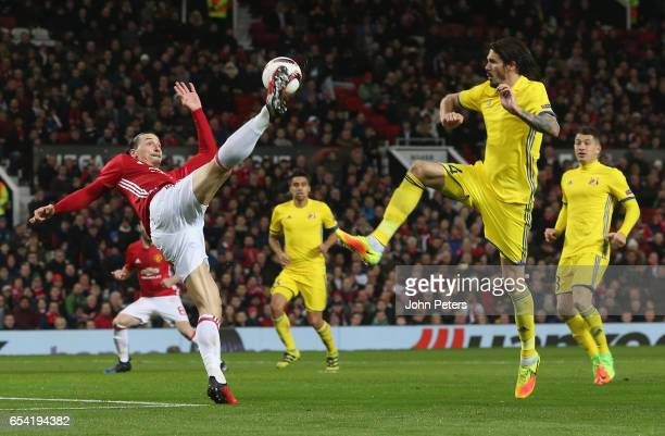 Zlatan Ibrahimovic of Manchester United in action with Cesar Navas of FK Rostov during the UEFA Europa League Round of 16 second leg match between...