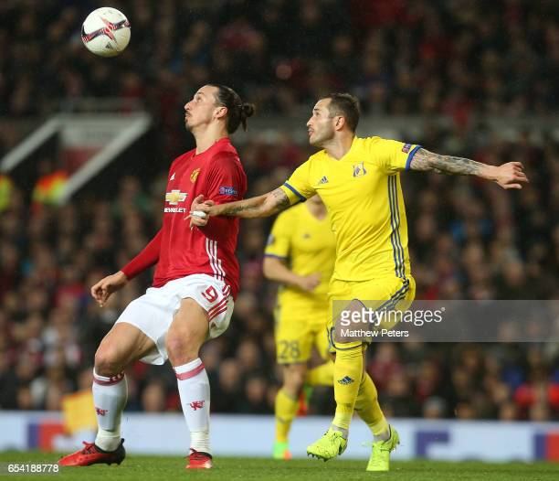 Zlatan Ibrahimovic of Manchester United in action with Fedor Kudryashov of FK Rostov during the UEFA Europa League Round of 16 second leg match...