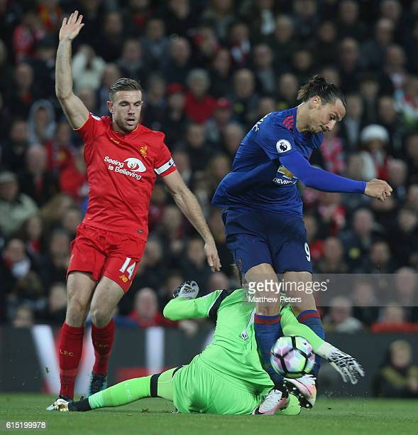 Zlatan Ibrahimovic of Manchester United in action with Jordan Henderson and Loris Karius of Liverpool during the Premier League match between...