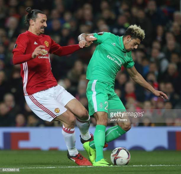 Zlatan Ibrahimovic of Manchester United in action with Kevin Malcuit of AS SaintEtienne during the UEFA Europa League Round of 32 first leg match...