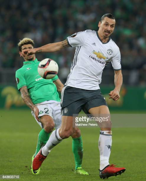 Zlatan Ibrahimovic of Manchester United in action with Kevin Malcuit of AS SaintEtienne during the UEFA Europa League Round of 32 second leg match...