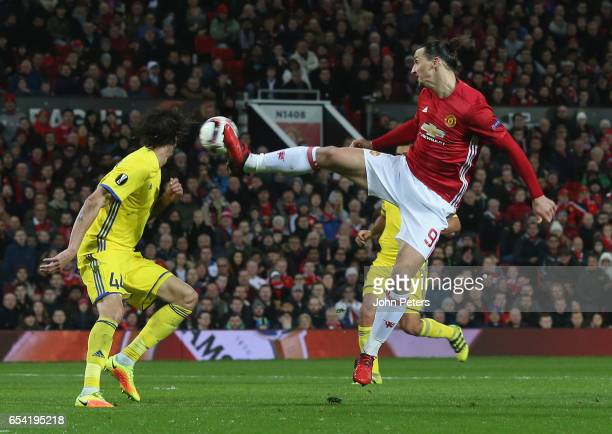 Zlatan Ibrahimovic of Manchester United in action with Khoren Bayramyan of FK Rostov during the UEFA Europa League Round of 16 second leg match...