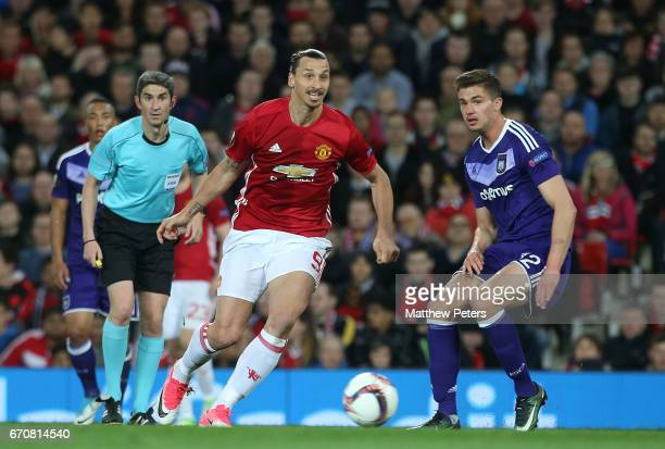 Zlatan Ibrahimovic of Manchester United in action with Leander Dendoncker of RSC Anderlecht during the UEFA Europa League quarter final second leg...