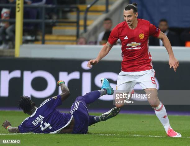 Zlatan Ibrahimovic of Manchester United in action with Mbodji Kara of ASC Anderlecht during the UEFA Europa League quarter final first leg match...