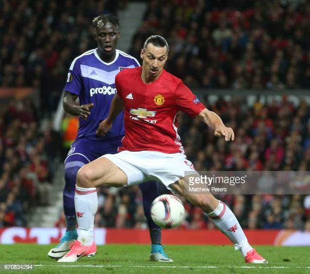 Zlatan Ibrahimovic of Manchester United in action with Mbodji Kara of RSC Anderlecht during the UEFA Europa League quarter final second leg match...
