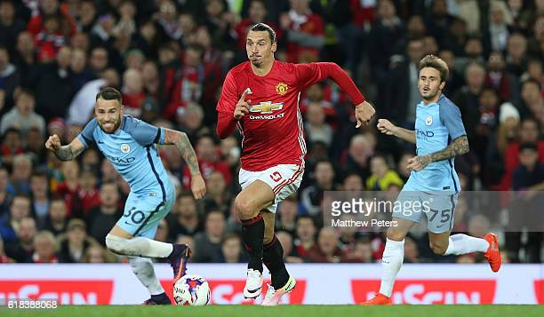 Zlatan Ibrahimovic of Manchester United in action with Nicolas Otamendi and Aleix Garcia of Manchester City during the EFL Cup Fourth Round match...