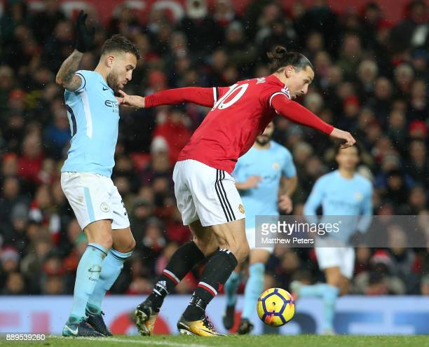 Zlatan Ibrahimovic of Manchester United in action with Nicolas Otamendi of Manchester City during the Premier League match between Manchester United...