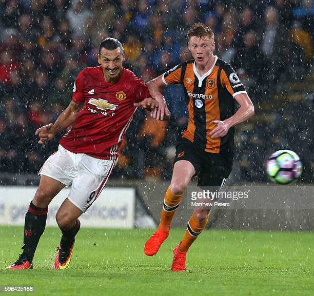 Zlatan Ibrahimovic of Manchester United in action with Sam Clucas of Hull City during the Premier League match between Manchester United and Hull...