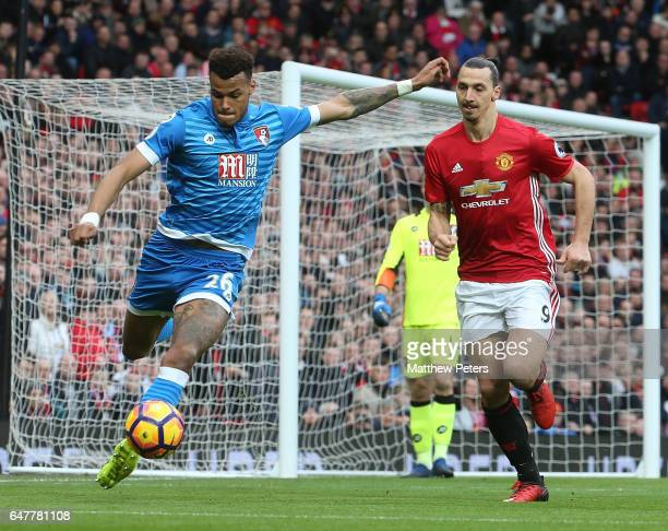 Zlatan Ibrahimovic of Manchester United in action with Tyrone Mings of AFC Bournemouth during the Premier League match between Manchester United and...