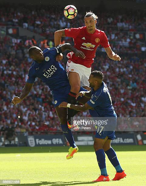 Zlatan Ibrahimovic of Manchester United in action with Wes Morgan and Danny Simpson of Leicester City during the FA Community Shield match between...