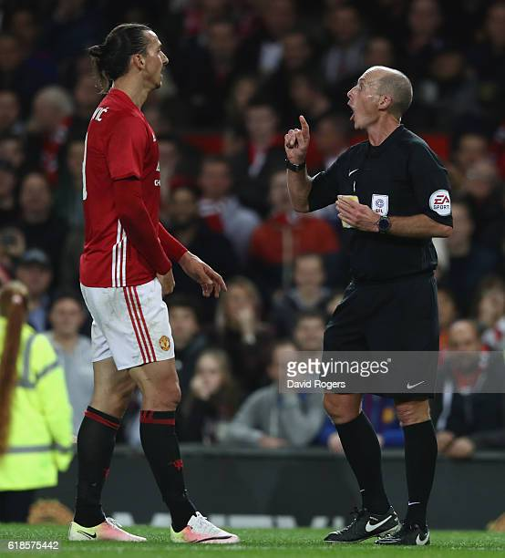 Zlatan Ibrahimovic of Manchester United is cautioned by referee Mike Dean during the EFL Cup Fourth Round match between Manchester United and...