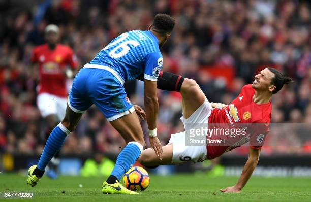 Zlatan Ibrahimovic of Manchester United is challenged by Tyrone Mings of AFC Bournemouth during the Premier League match between Manchester United...