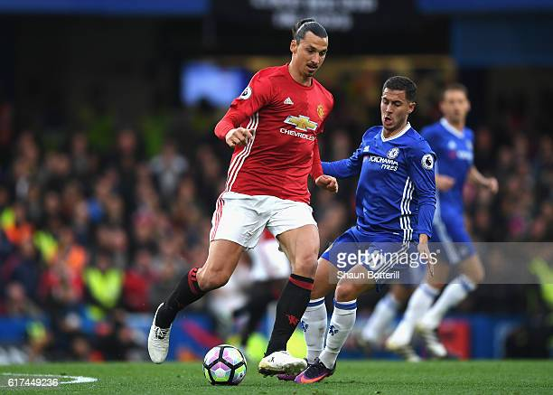 Zlatan Ibrahimovic of Manchester United is closed down by Eden Hazard of Chelsea during the Premier League match between Chelsea and Manchester...