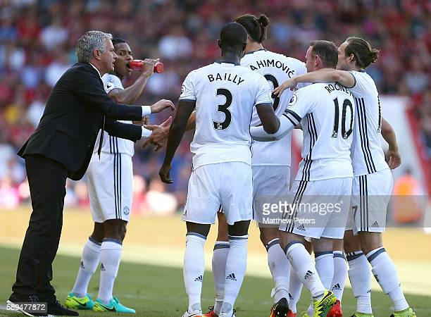 Zlatan Ibrahimovic of Manchester United is congratulated by Manager Jose Mourinho after scoring the third goal to make the score 03 during the...