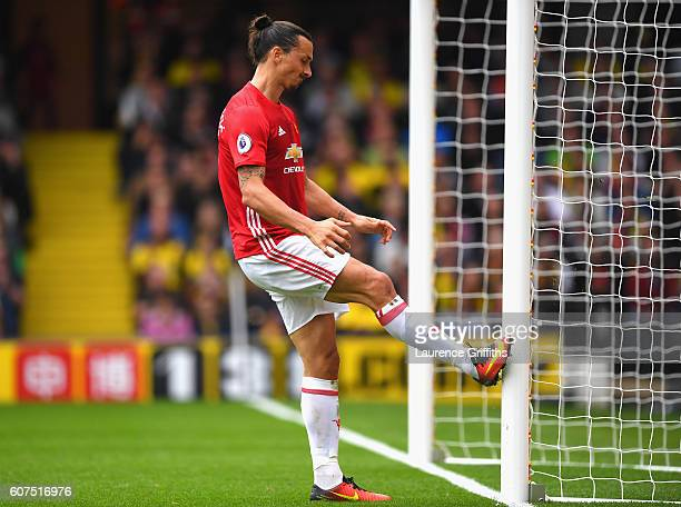 Zlatan Ibrahimovic of Manchester United kicks the post in frustration after Watford score their second goal of the game during the Premier League...