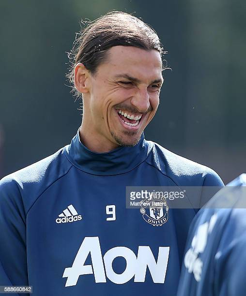 Zlatan Ibrahimovic of Manchester United laughs during a first team training session at Aon Training Complex on August 12 2016 in Manchester England
