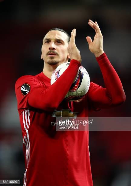 Zlatan Ibrahimovic of Manchester United leaves the pitch with the match ball after scoring a hattrick during the UEFA Europa League Round of 32 first...