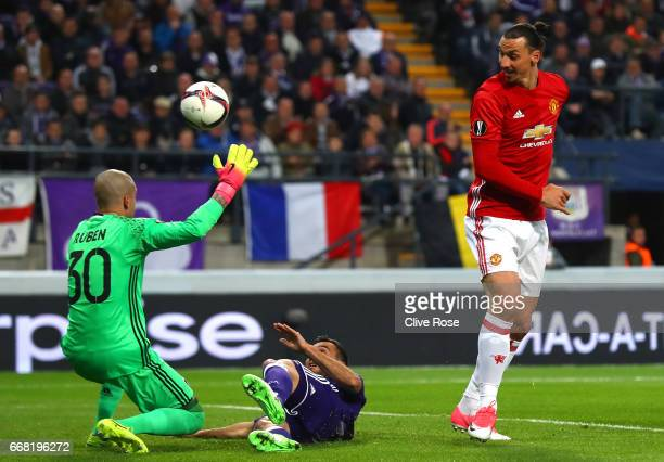 Zlatan Ibrahimovic of Manchester United misses a chance as Martinez Ruebn of RSC Anderlecht attempts to save during the UEFA Europa League quarter...