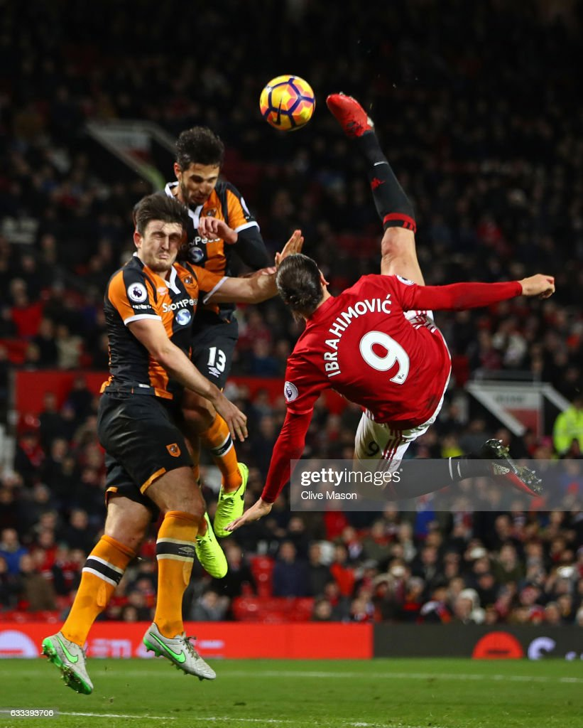 Zlatan Ibrahimovic of Manchester United performs an acrobatic kick with Harry Maguire and Andrea Ranocchia of Hull City during the Premier League match between Manchester United and Hull City at Old Trafford on February 1, 2017 in Manchester, England.