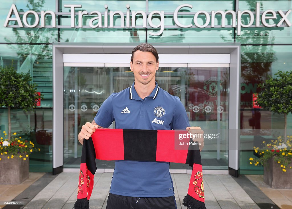 Zlatan Ibrahimovic of Manchester United poses after signing for the club at Aon Training Complex on July 1 2016 in Manchester England