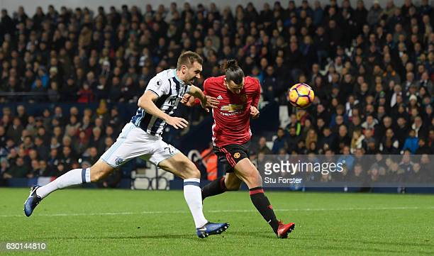 Zlatan Ibrahimovic of Manchester United scores his sides first goal with a header during the Premier League match between West Bromwich Albion and...