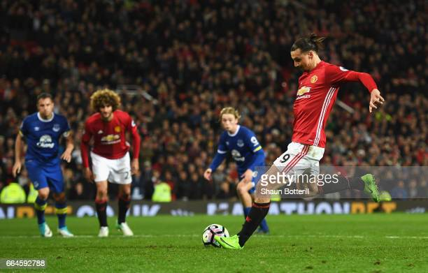 Zlatan Ibrahimovic of Manchester United scores his sides first goal from the penalty spot during the Premier League match between Manchester United...