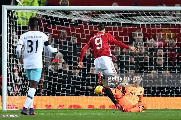 Zlatan Ibrahimovic of Manchester United scores the opening goal past goalkeeper Adrian of West Ham United during the EFL Cup quarter final match...