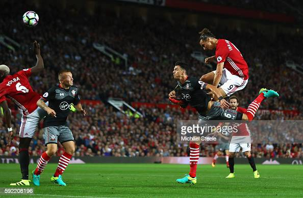 Zlatan Ibrahimovic of Manchester United scores the opening goal with a header during the Premier League match between Manchester United and...