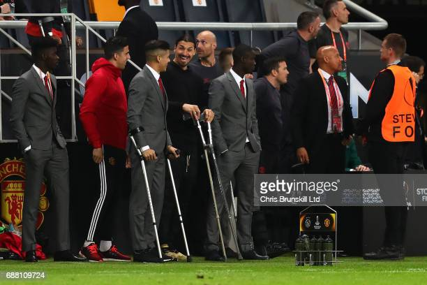 Zlatan Ibrahimovic of Manchester United shares a laugh with teammate Marcus Rojo on the touchline during the UEFA Europa League Final match between...
