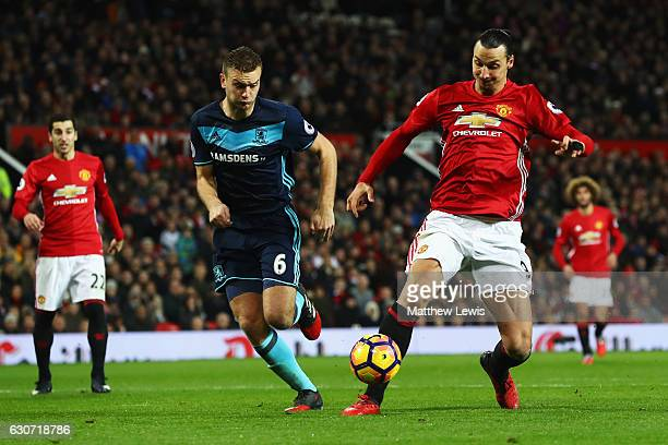 Zlatan Ibrahimovic of Manchester United shoots on goal in front of Ben Gibson of Middlesbrough during the Premier League match between Manchester...