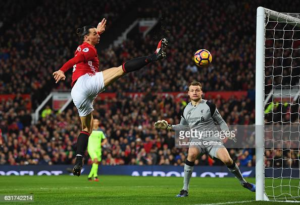 Zlatan Ibrahimovic of Manchester United stretches for the ball as Simon Mignolet of Liverpool looks on during the Premier League match between...