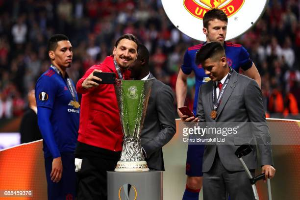 Zlatan Ibrahimovic of Manchester United takes a selfie with the trophy following the UEFA Europa League Final match between Ajax and Manchester...