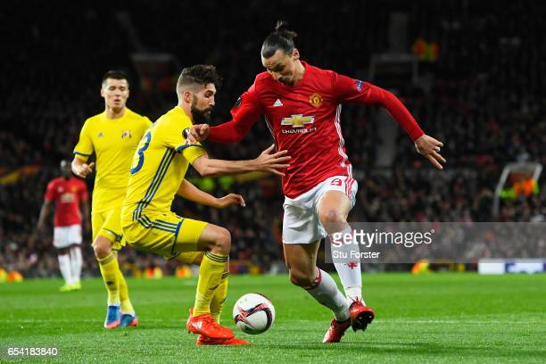 Zlatan Ibrahimovic of Manchester United takes on Miha Mevlja of FC Rostov during the UEFA Europa League Round of 16 second leg match between...