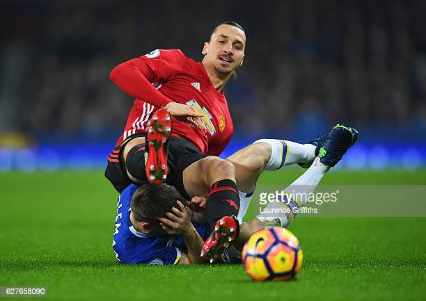 Zlatan Ibrahimovic of Manchester United tangles with Seamus Coleman of Everton as they battle for the ball during the Premier League match between...